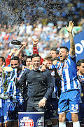 Wigan Manager Gary Caldwell and Wigan Defender Leon Barnett as Manager Caldwell lifts the League One Trophy after the Sky Bet League 1 match between Wigan Athletic and Barnsley at the DW Stadium, Wigan, England on 8 May 2016. Photo by John Marfleet.