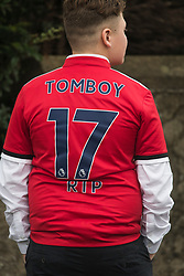 "© Licensed to London News Pictures. 26/10/2017. Epsom, UK. A young man wearing ""R.I.P 17 TOMBOY"" on the back of Manchester United football shirts. Funeral of Tom 'Tomboy' Doherty the nephew of Big Fat Gypsy Weddings star Paddy Doherty, at Epsom Cemetery in Epsom, Surrey. Tom Doherty was 17 when he was killed in a car crash in South Nutfield in Surrey on October 9. He had passed his driving test just days earlier. Photo credit: Ben Cawthra/LNP"