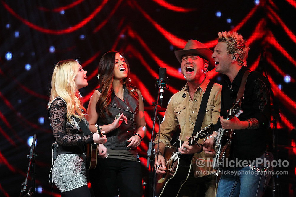 Gloriana performs at the Best Buy Country Music Expo at the Indiana State Fairgrounds in Indianapolis, Indiana.