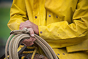 Cowboy in Yellow Slicker Holding Rope, Montana