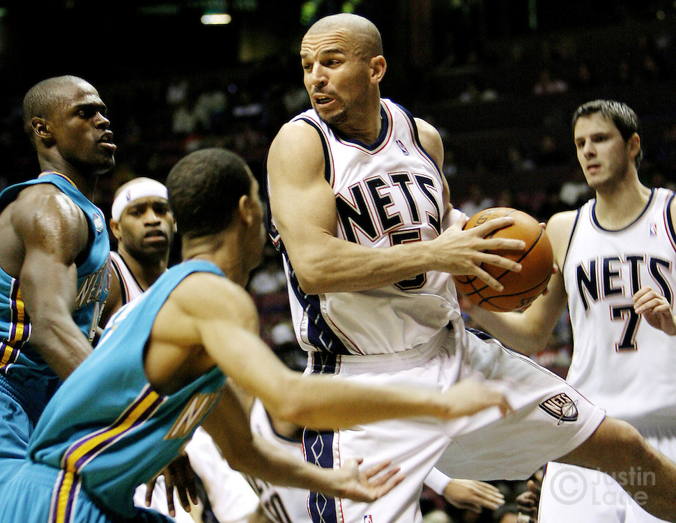 Jason Kidd (2nd from R) grabs a rebound in front of the Hornets' Chris Paul (2nd from L) and Mark Johnson (L) during the first half of the game between the New Orleans/Oklahoma City Hornets and the New Jersey Nets at Continental Airlines Arena in East Rutherford, New Jersey on Wednesday 21 February 2007. At right is the Nets' Bostian Nachbar.