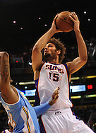 Oct. 22 2010; Phoenix, AZ, USA; Phoenix Suns forward-center Robin Lopez (15) puts up a basket during the first half against Denver Nuggets power forward Renaldo Balkman (32) during a preseason game at the US Airways Center. Mandatory Credit: Jennifer Stewart-US PRESSWIRE.
