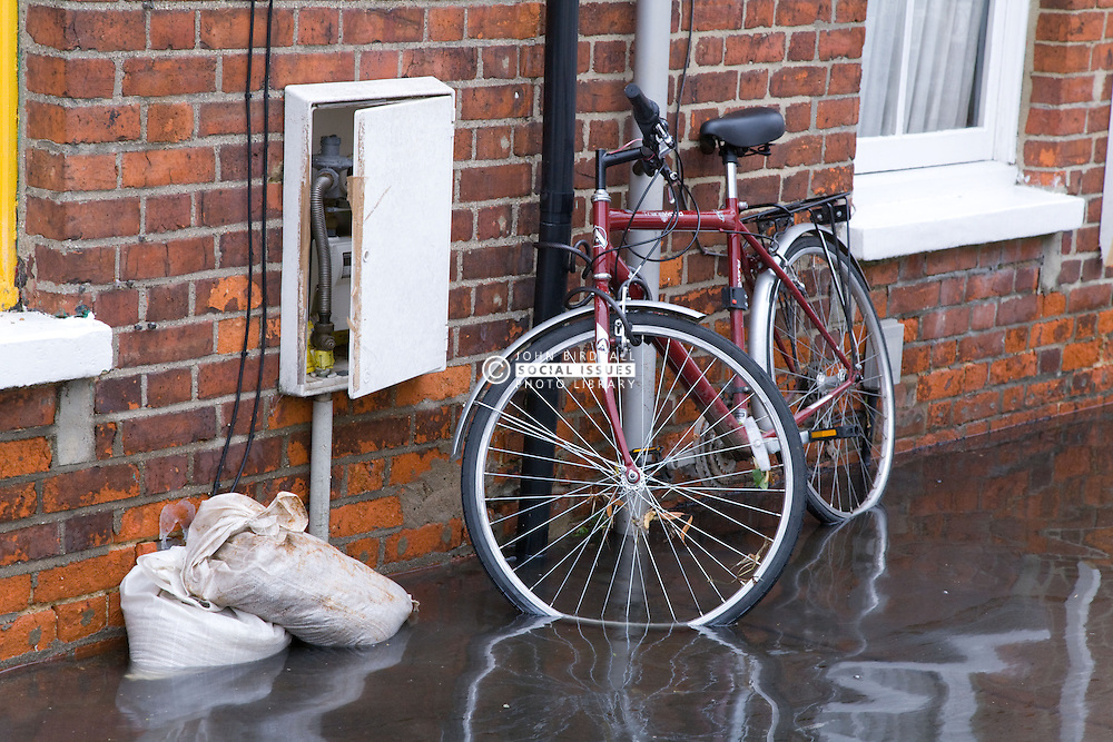 Bicycle outside house in flooded street after torrential rain caused flooding in Oxford and the Thames Valley area; July 2007,