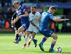 Leon Britton of Swansea is challenged by Ryan Shawcross of Stoke City -Mandatory by-line: Nizaam Jones/JMP- 13/05/2018 - FOOTBALL - Liberty Stadium - Swansea, Wales - Swansea City v Stoke City - Premier League