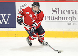 PITTSBURGH, PA - OCTOBER 14:  Maeve Garvey #15 of the Robert Morris Colonials skates with the puck in the first period during the game against the Vermont Catamounts at 84 Lumber Arena on October 14, 2016 in Pittsburgh, Pennsylvania. (Photo by Justin Berl)