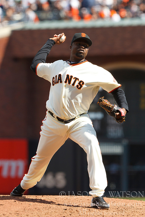 April 8, 2011; San Francisco, CA, USA;  San Francisco Giants relief pitcher Guillermo Mota (59) pitches against the St. Louis Cardinals during the sixth inning at AT&T Park.
