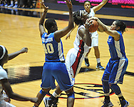 """Ole Miss' Courtney Marbra (25) is tied up by Kentucky's Jennifer O'Neill (0) as Brittany Henderson (40) also defends in women's college basketball at the C.M. """"Tad"""" Smith Coliseum in Oxford, Miss. on Thursday, February 28, 2013. Kentucky won 90-65."""