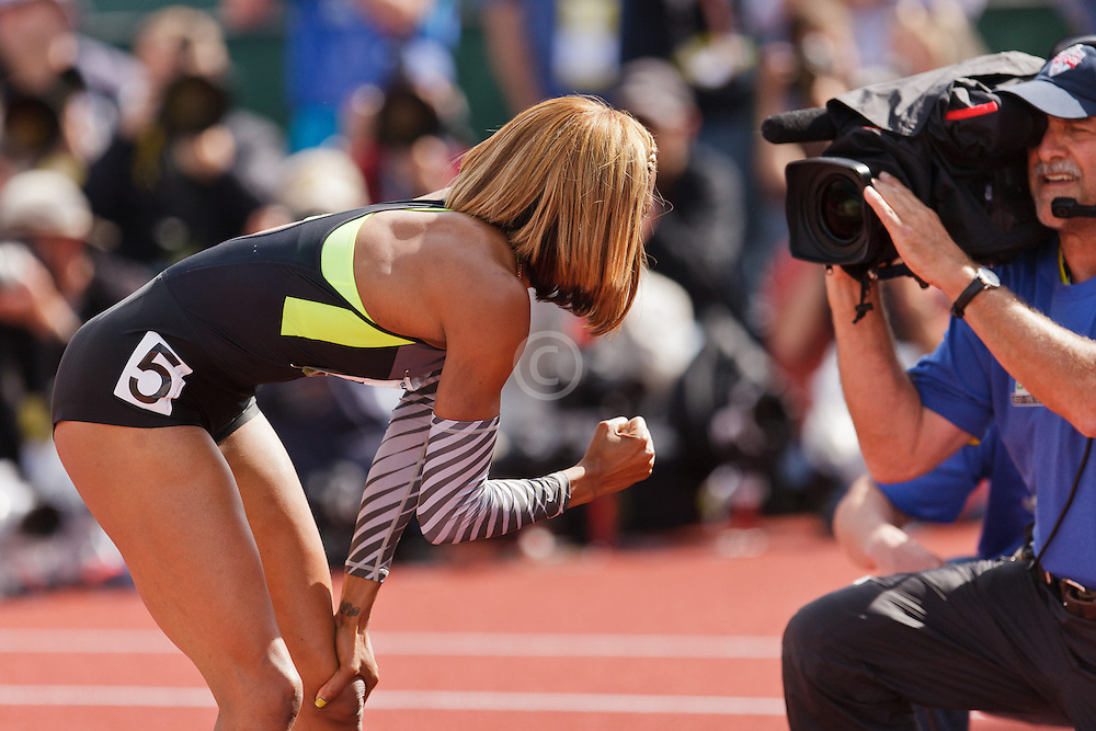 Sanya Richards-Ross, Women's 400 meters, champion, Olympian, pumps fist for NBC camera after winning