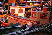 Usa, Newport RI - Docked fishing boats rest in the late afternoon sun ..