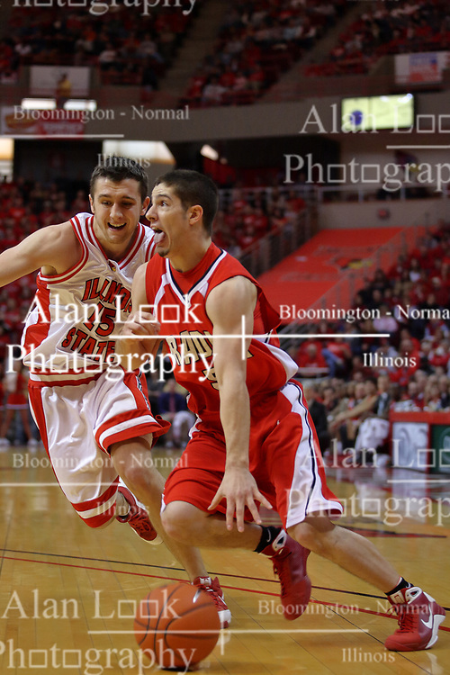 """31 January 2009: Sam Maniscalco runs the baseline looking for the paint with Sead Odzic defending. The Illinois State University Redbirds join the Bradley Braves in a tie for 2nd place in """"The Valley"""" with a 69-65 win on Doug Collins Court inside Redbird Arena on the campus of Illinois State University in Normal Illinois"""