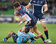 Mitch Inman (Rebels) is tackled by Peter Betham (Waratahs) during the Round 15 match of the 2013 Super Rugby Championship between RaboDirect Rebels vs HSBC Waratahs at AAMI Park, Melbourne, Victoria, Australia. 24/05/0213. Photo By Lucas Wroe