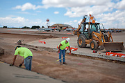 Construction laborers Jaysen Raymond and Michael W. Lotes at work building new runways at Holloman Air Force Base in Otero County. HAFB received over $21 million to upgrade various facilities as part of the Recovery and Reinvestment Act.
