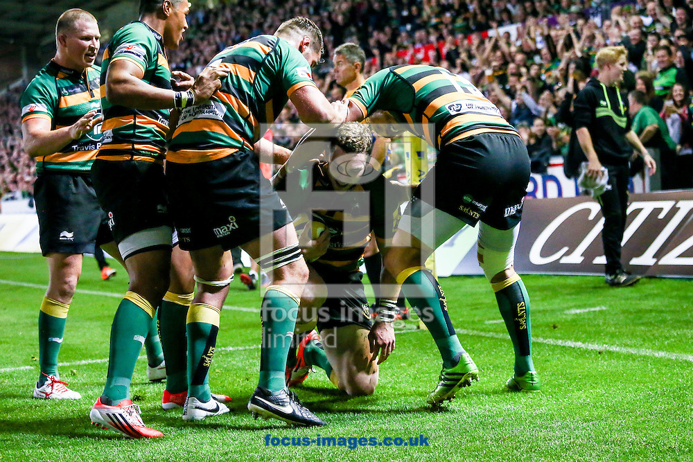 Northampton players mob George North after he's scored a try during the Aviva Premiership match at Franklin's Gardens, Northampton<br /> Picture by Andy Kearns/Focus Images Ltd 0781 864 4264<br /> 05/09/2014