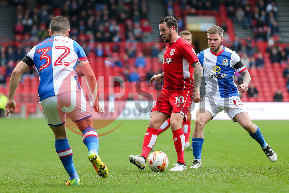 Lee Tomlin of Bristol City is challenged by Danny Guthrie of Blackburn Rovers - Rogan Thomson/JMP - 22/10/2016 - FOOTBALL - Ashton Gate Stadium - Bristol, England - Bristol City v Blackburn Rovers - Sky Bet EFL Championship.