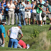 Jordan Spieth, USA, looks for his ball in the rough on the twelfth hole during the second round of The Barclays Golf Tournament at The Plainfield Country Club, Edison, New Jersey, USA. 28th August 2015. Photo Tim Clayton