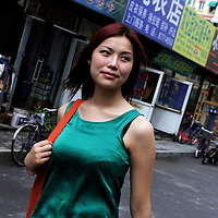 "BEIJING, 29.July 2004 : Yang Yuan, 19, an aspiring model who made headlines in May when she sued the organizer of a beauty pageant, walks in a street outside the hospital where she went under the knife in Beijing, July 29, 2004, in China. ..Yang Yuan says she wanted to improve her career chances and therefore improved her looks artificially.When the organizer of the beauty contest found out, he banned her from competing and Yang's ""nightmare"" started. Yang has spent a fortune to pay her team of lawyers, organize press conferences to fight for her rights...These days, she's been obliged to give up her apartment as she slowly runs out of money and model jobs are not coming .In order to make a living, Yang agreed to act as an ""ambassador"" for the hospital where she had her plastic surgery...Plastic surgery gradually is becoming big business in China's capital.  Since this summer , hospitals  have been flooded with teenage patients ever since offers ""special summer reductions"" for students were made..  ..Whereas in Mao Zedong's China, even pigtails were seen as a sign of vanity (and had to be cut off) , nowadays, urban Chinese women seek about every means in order to distinguish themselves from the masses.  This year Beijing will organize the worl'd first beauty pageant for women had had plastic surgery..."