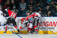 KELOWNA, CANADA - OCTOBER 31: Tyson Baillie #24 checks Arvin Atwal #4 of the Lethbridge Hurricanes into the boards during first period on October 31, 2015 at Prospera Place in Kelowna, British Columbia, Canada.  (Photo by Marissa Baecker/Shoot the Breeze)  *** Local Caption *** Tyson Baillie; Arvin Atwal;