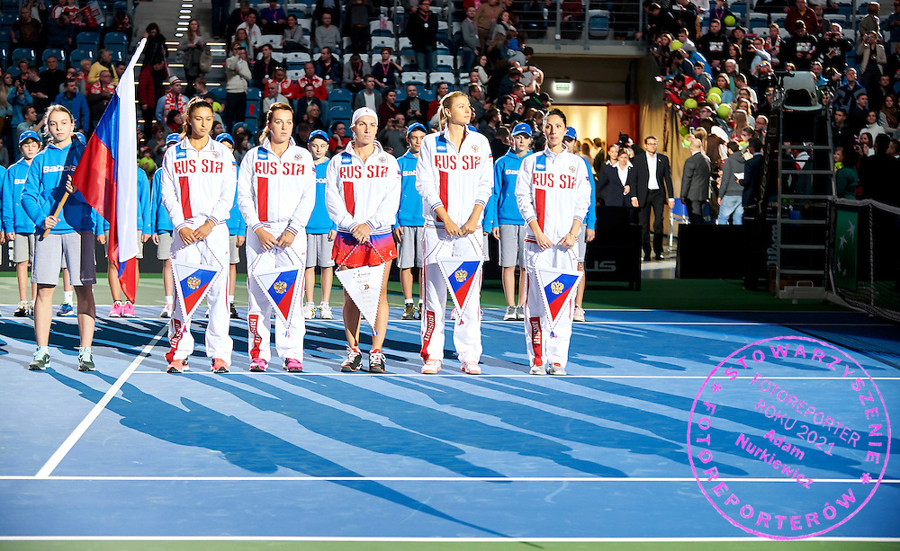 (L-R) Vitalia Diatchenko and Anastasia Pavyuchenkova and Svetlana Kuznetsova and Maria Sharapova and trainer coach Anastasia Myskina all from Russia while national anthem during First Day of the Fed Cup / World Group 1st round tennis match between Poland and Russia at Tauron Krakow Arena on February 7, 2015 in Cracow, Poland.<br /> <br /> Poland, Cracow, February 7, 2015<br /> <br /> Picture also available in RAW (NEF) or TIFF format on special request.<br /> <br /> For editorial use only. Any commercial or promotional use requires permission.<br /> <br /> Adam Nurkiewicz declares that he has no rights to the image of people at the photographs of his authorship.<br /> <br /> Mandatory credit:<br /> Photo by &copy; Adam Nurkiewicz / Mediasport