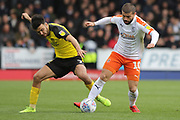 Luton Town forward Elliot Lee wins the ball from Burton Albion midfielder Scott Fraser during the EFL Sky Bet League 1 match between Burton Albion and Luton Town at the Pirelli Stadium, Burton upon Trent, England on 27 April 2019.