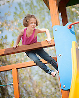 Young girl climbing on childrens playground