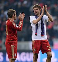 FUSSBALL  CHAMPIONS LEAGUE  ACHTELFINALE  HINSPIEL  2012/2013      FC Bayern Muenchen - FC Arsenal London     13.03.2013 Philipp Lahm (li) und Thomas Mueller (re, beide FC Bayern Muenchen) freuen sich nach dem Abpfiff