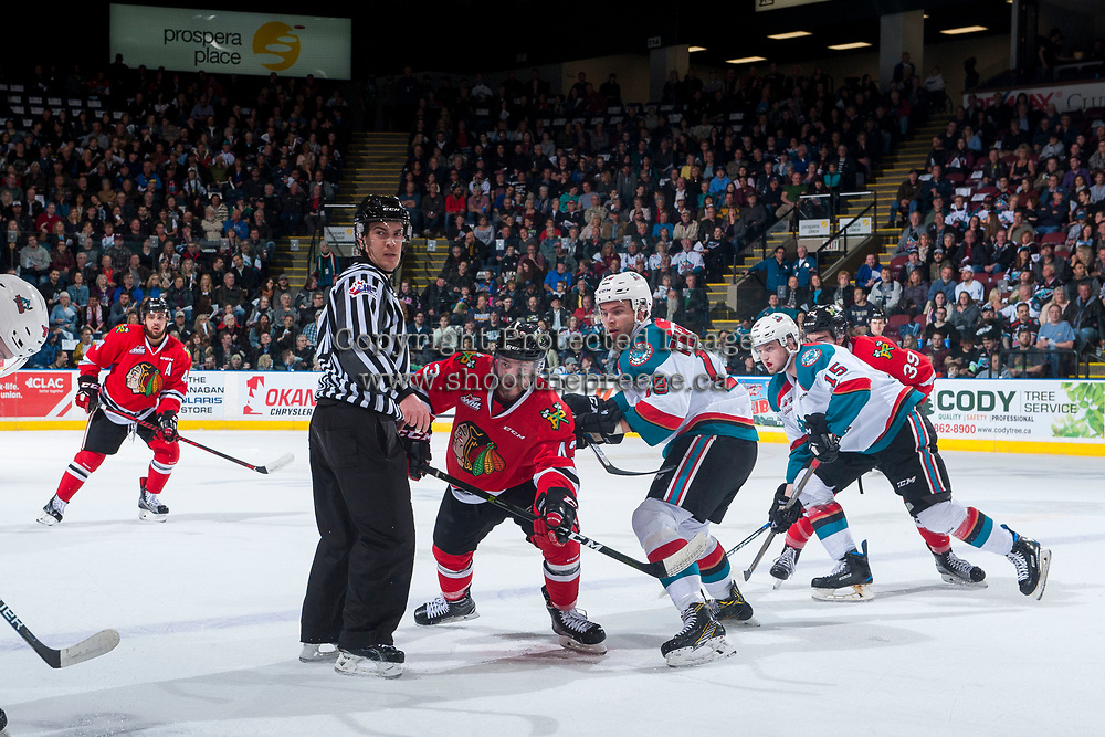 KELOWNA, CANADA - APRIL 7: Skyler McKenzie #43 of the Portland Winterhawks wins the face off against Carsen Twarynski #18 of the Kelowna Rockets during first period on April 7, 2017 at Prospera Place in Kelowna, British Columbia, Canada.  (Photo by Marissa Baecker/Shoot the Breeze)  *** Local Caption ***