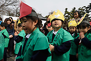 Japanese children in ceremonial kamishimo kimono jackets walk through Sensoji Temple in Tokyo February 3, 2018, the day before the beginning of spring according to the Japanese lunar calendar. The youngsters assembled marking Setsubun (seasonal division), in celebration of the coming of spring and to drive out bad luck. 03/02/2018-Tokyo, JAPAN