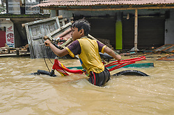 July 27, 2017 - Kolkata, west bengal, india - Udaynarayanpur, a village of Howrah district .of West Bengal, India, where flood take place. On thursday 27th July 2017 Damodar valley .corporation (DVC) release more water from its dams and sounded  red alert on surrounding .areas villages including Udaynarayanpur. The disaster takes place when barrage .at Udaynarayanpur broken due to heavy flow of water that comes from dams. Till date 90 .villages submerged as per local officials report. (Credit Image: © Debsuddha Banerjee via ZUMA Wire)