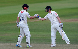 Sussex's Ed Joyce celebrates his half century with Sussex's Matt Machan. - Photo mandatory by-line: Harry Trump/JMP - Mobile: 07966 386802 - 07/07/15 - SPORT - CRICKET - LVCC - County Championship Division One - Somerset v Sussex- Day Three - The County Ground, Taunton, England.