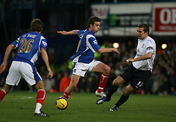 PORTSMOUTH, ENGLAND - SATURDAY, DECEMBER 9th, 2006: Sean Davis of Portsmouth clashes with Alan Stubbs of Everton during the Premiership match at Fratton Park. (Pic by Chris Ratcliffe/Propaganda)