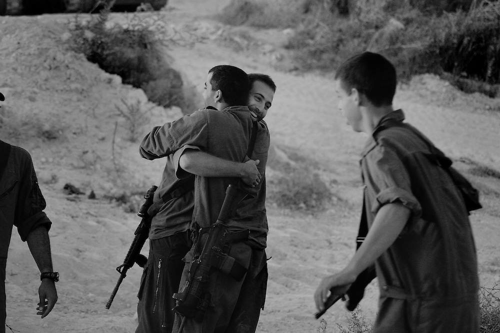 Old friends greet each other in forward camp on the Israel/Lebanon border. Aug 2006