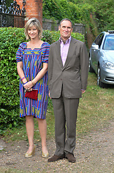 NICOLA FORMBY and A A GILL attending Annabel Goldsmith's Summer party held at her home in Ham, Surrey on 10th July 2014.