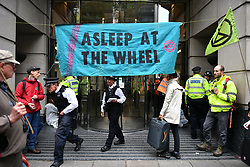 © Licensed to London News Pictures. 08/10/2019. London, UK. Extinction Rebellion activists demonstrate at Department for Transport in Westminster. Activists have converged on Westminster for a second day, blockading roads in the area and calling on government departments to 'Tell the Truth' about what they are doing to tackle the Emergency. Photo credit: Ben Cawthra/LNP