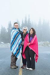 Portrait of family visiting Mt. Rainier National Park, WA.
