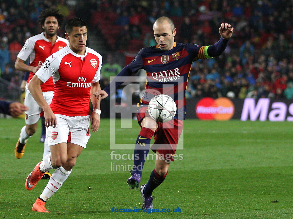 Andres Iniesta of FC Barcelona and Alexis Sanchez of Arsenal during the UEFA Champions League match at Camp Nou, Barcelona<br /> Picture by Yannis Halas/Focus Images Ltd +353 (87) 258201<br /> 16/03/2016