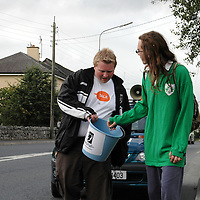 """26/08/05<br />Dave McDonagh, Sligo, who is a member of Young Fine Gael collecting money from motorists in Ennis as part of there walk from Galway to Limerick to raise funds and highlight the work of """"AWARE"""", who work to help combat depression in Ireland. <br />Picture. Cathal Noonan/Press22."""