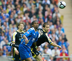 LONDON, ENGLAND - Saturday, May 17, 2008: Cardiff City's Roger Johnson and Portsmouth's Nwankwo Kanu during the FA Cup Final at Wembley Stadium. (Photo by Chris Ratcliffe/Propaganda)