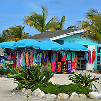 Berried Treasures Bazaar at Great Stirrup Cay, Bahamas<br /> These colorful huts are a small straw market called Berried Treasures Bazaar located near the tender docks. No, the sign is not misspelled. The moniker is a play on words of the Berry Islands where Great Stirrup Cay is located. Shopaholics may be disappointed by the selection of clothes, crafts and souvenirs. Yet you may find a perfect memento to take home as a remembrance of your Bahaman cruise. The merchants live in the neighboring island of Great Harbour Cay and are independent of NCL. Consequently, purchases cannot be added to your room account but U.S. dollars are gladly accepted.