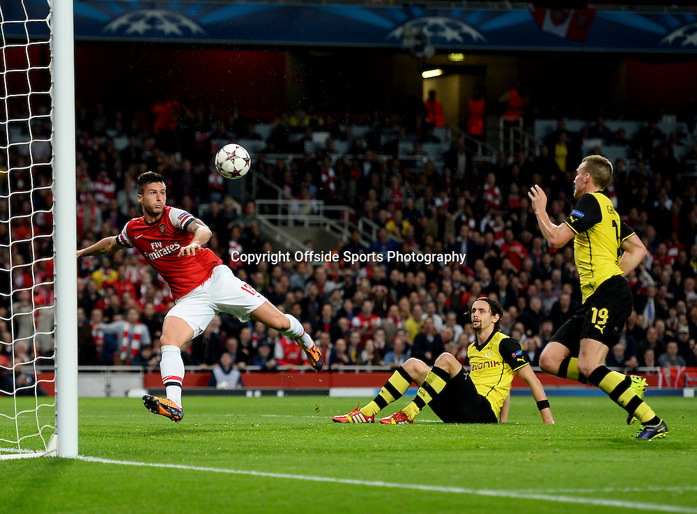 21st October 2013 - UEFA Champions League Group F - Arsenal v Borussia Dortmund - Olivier Giroud of Arsenal scores the equalising goal - Photo: Marc Atkins / Offside.