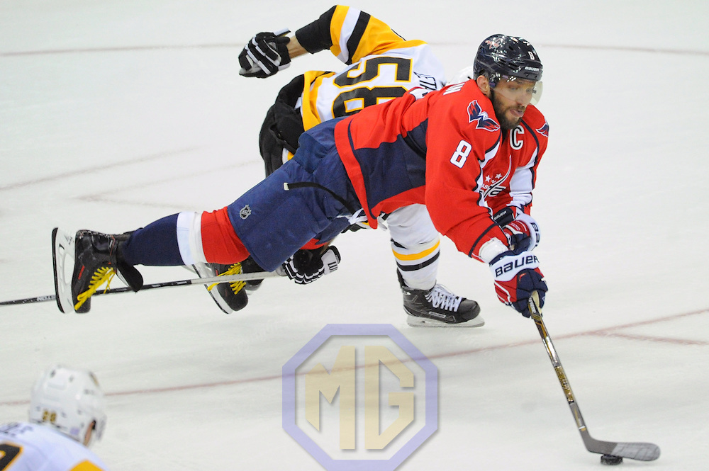 WASHINGTON, DC - NOVEMBER 16: Washington Capitals left wing Alex Ovechkin (8) is tripped and injured by Pittsburgh Penguins defenseman Kris Letang (58) in the second period on November 16, 2016, at the Verizon Center in Washington, D.C. (Photo by Mark Goldman/Icon Sportswire)