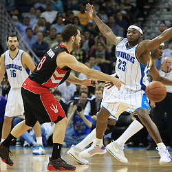 06 February 2009:  Toronto Raptors guard Jose Calderon (8) passes as New Orleans Hornets guard Devin Brown (23) defends the play during a 101-92 win by the New Orleans Hornets over the Toronto Raptors at the New Orleans Arena in New Orleans, LA.
