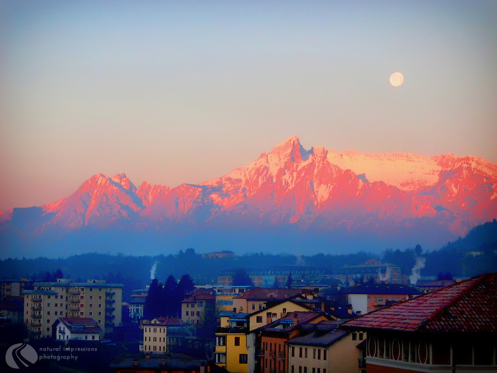 Full moonrise over Belluno, a town in the northern region of Italy.  Belluno sits at the base of the Dolomite mountain range.