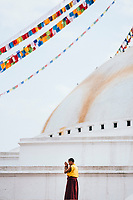 A young monk prays during his morning ritual at Boudhanath Temple.
