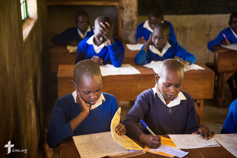 Several pictured students (front row) from the U-Dom ELCK (Evangelical Lutheran Church in Kenya) Project 24 site prepare for exams on Thursday, June 23, 2016, at the Propoi Primary School in Chepareria, Kenya.  LCMS Communications/Erik M. Lunsford