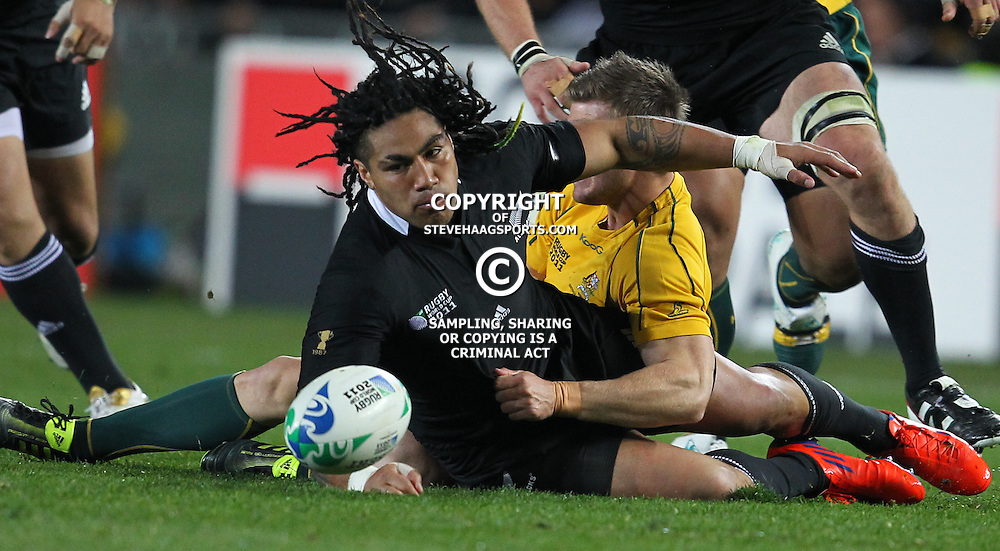 AUCKLAND, NEW ZEALAND - OCTOBER 16, Ma'a Nonu tackled by Pat McCabe  during the 2011 IRB Rugby World Cup Semi Final match between New Zealand and Australia at Eden Park on October 16, 2011 in Auckland, New Zealand<br /> Photo by Steve Haag / Gallo Images