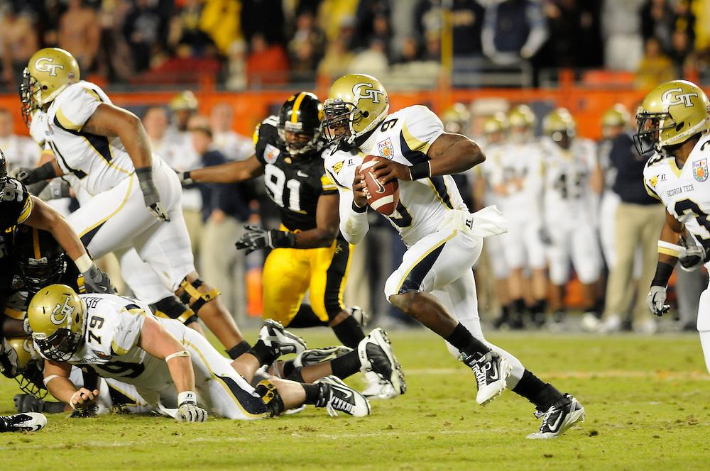 January 5, 2010: Quarterback Josh Nesbitt of the Georgia Tech Yellow Jackets runs upfield during the NCAA football game between the Georgia Tech Yellow Jackets and the Iowa Hawkeyes in the Orange Bowl. The Hawkeyes were leading the Yellow Jackets 14-7 at halftime.