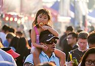6月30日,一名女孩在626夜市享用美食。当天 ,在美国洛杉矶阿卡迪亚市的圣安娜公园举行626夜市。上百个美食摊位、汇集了洛杉矶周围几乎所有的华人小吃,吸引大批民众参与。新华社发 (赵汉荣摄)<br /> A girl enjoys food before nightfall at the '626 Night Market' on June 30, 2017 in Arcadia, Caliifronia, the United States. 626 Night Market IS an event that attracts all generations of the Chinese American community and showcases many San Gabriel Valley food vendors. (Xinhua/Zhao Hanrong)(Photo by Ringo Chiu)<br /> <br /> Usage Notes: This content is intended for editorial use only. For other uses, additional clearances may be required.