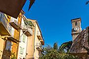Facades de maisons du quartier du Suquet avec au fond le clocher de l'eglise Notre-dame d'Espérance// Houses facades in Le Suquet district with church Notre-Dame de l'Espérance at the back
