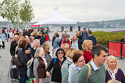 Dundee, Scotland, UK. 23 June 2019. The BBC Antiques Roadshow TV programme is aiming on location t the new V&A Museum in Dundee today. Long queues formed as members of the public arrived with their collectables to have them appraised and valued by the Antiques Roadshow experts. Select items and their owners were chosen to be filmed for the show. Pictured, Long queues formed for antique valuation