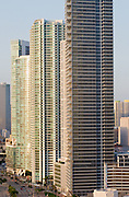 highrise office and apartment buildings in downtown miami at sunrise.